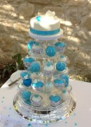 A mix of temari and cupcakes in shades of turquoise finished with butterflies, flowers and handpiped designs