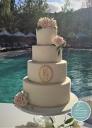 Four tier with gold plaque and sugar roses