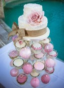 Temari and Cupcakes in variety of designs topped with a two tier cake, coated in lace copied from the Bride's dress and finished with a sugar rose