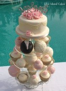 Temari and cupcake tower in pink and ivory finished with pearls, gypshopila and roses