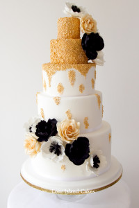 Five tier with handpiped texture painted with edible gold finished with gold roses and black & white fantasy poppies