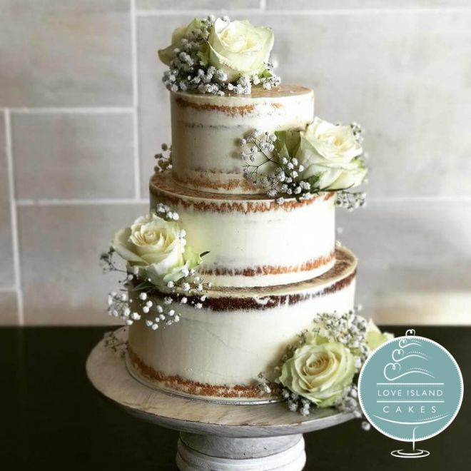 Semi naked cake with fresh ivory roses