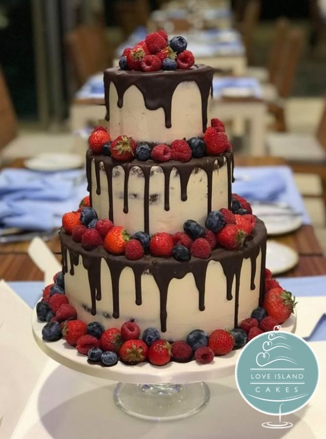 Semi naked with chocolate drips and fresh berries