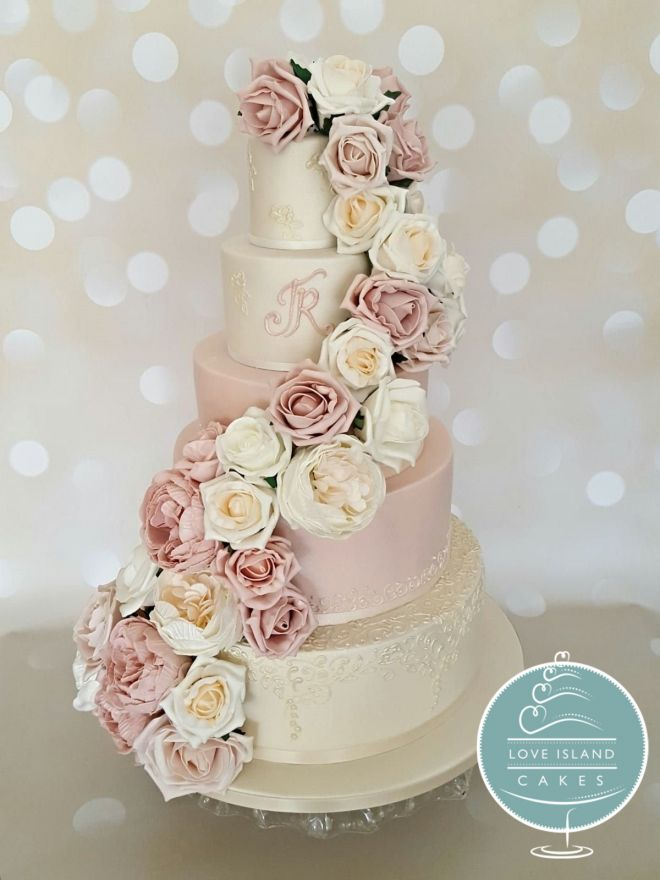 pink and lustre lace with full cascade of artificial flowers