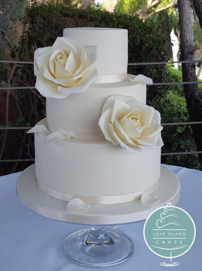 Three tier with ivory sugar roses